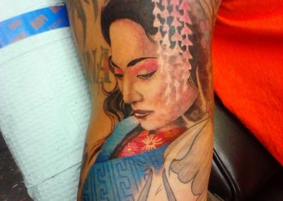 Woman tattoo By Billy Muren
